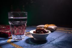 Water and dates. Iftar is the evening meal. View of decoration Ramadan Kareem holiday on carpet. Festive greeting card, invitation. For Muslim holy month stock images