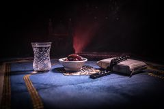 Water and dates. Iftar is the evening meal. View of decoration Ramadan Kareem holiday on carpet. Festive greeting card, invitation. For Muslim holy month royalty free stock image