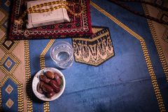 Water and dates. Iftar is the evening meal. View of decoration Ramadan Kareem holiday on carpet. Festive greeting card, invitation. For Muslim holy month royalty free stock photo