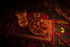 Water and dates. Iftar is the evening meal. View of decoration Ramadan Kareem holiday on carpet. Festive greeting card, invitation. For Muslim holy month royalty free stock photography