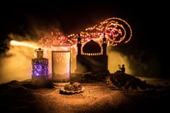 Water and dates. Iftar is the evening meal. View of decoration Ramadan Kareem holiday on sand. Festive greeting card, invitation. For Muslim holiday. Selective stock photography