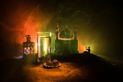 Water and dates. Iftar is the evening meal. View of decoration Ramadan Kareem holiday on sand. Festive greeting card, invitation. For Muslim holiday. Selective royalty free stock photography
