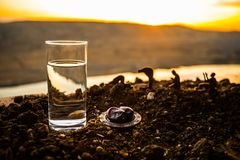 Water and dates. Iftar is the evening meal. View of decoration Ramadan Kareem holiday on sand. Festive greeting card, invitation. For Muslim holiday. Selective royalty free stock images