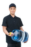 Water delivering. Front view of confident young deliveryman hold Stock Photos