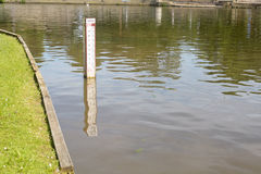 Water depth marker in river Royalty Free Stock Image