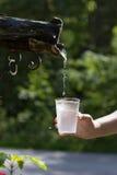 Water die van een tapkraan druipen Royalty-vrije Stock Fotografie