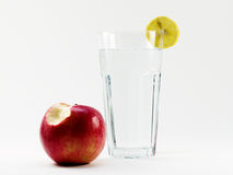 Water diet. Glass of pure water with apple Royalty Free Stock Photos