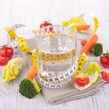 Water and dietetic vegetable Royalty Free Stock Photography
