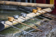 Water dipper on front of shrine Royalty Free Stock Images