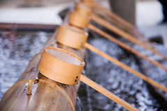 Water dipper for hand cleanse in Japanese temple Royalty Free Stock Image
