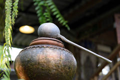 Water dipper made from coconut shell on Water Clay pots. In Thailand Stock Images