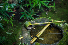 Water dipper on a stone basin at Koto-in Temple in Kyoto Royalty Free Stock Photography