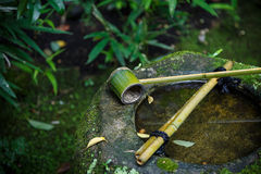 Water dipper on a stone basin at Koto-in Temple in Kyoto Royalty Free Stock Photo