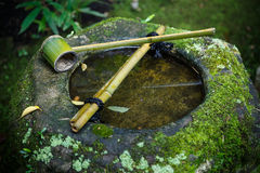 Water dipper on a stone basin at Koto-in Temple in Kyoto Stock Image