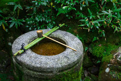 Water dipper on a stone basin at Koto-in Temple in Kyoto Royalty Free Stock Image