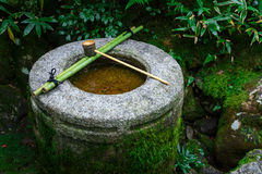 Water dipper on a stone basin at Koto-in Temple in Kyoto Royalty Free Stock Images