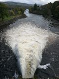 Water discharging from a dam. On the river Tummel, Pitlochry Stock Photography