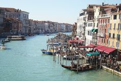 Water district of Venice. Sea channel with gondolas, pleasure boats on clear summer day. Travel to Italy. Outdoor stock photo