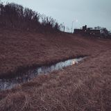 Water in the ditch by the on-ramp Stock Images