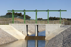 Water diversion canal. Almost finished sluice gate in the water diversion canal upstream the Alvito reservoir near Oriola village, part of the Alqueva Irrigation stock image