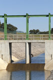 Water diversion canal. Almost finished sluice gate in the water diversion canal upstream the Alvito reservoir near Oriola village, part of the Alqueva Irrigation stock photo
