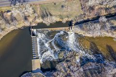 Water diversion dam aerial view. Water diversion dam on the South Platte River abover Brigthon, Colorado - aerial in early spring scenery royalty free stock image