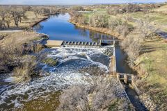 Water diversion dam aerial view. Water diversion dam on the South Platte River abover Brigthon, Colorado - aerial in early spring scenery stock photos