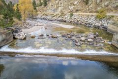 Water diversion dam in mountain canyon. Cache la Poudre River and water diversion dam in a canyon above Fort Collins, Colorado - aerial view with fall scenery stock photography