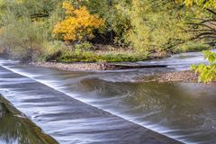 Water diversion dam on Poudre River. In Fort Collins, Colorado - fall colors scenery royalty free stock photos