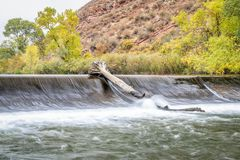 Water diversion dam on Poudre River. Near Fort Collins in northern Colorado - fall colors scenery royalty free stock photos