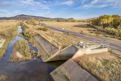 Water diversion ditch at foothills of Rocky Mountains. In northern Colorado - aerial view royalty free stock image