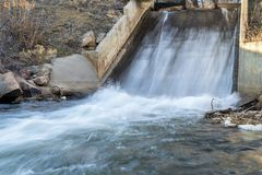 Water diversion in northern Colorado. A dam and water inlet to a reservoir stock photography