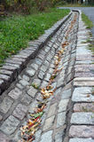 Water drain made of stones Stock Images