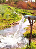 Water Draining into Stream royalty free stock photography