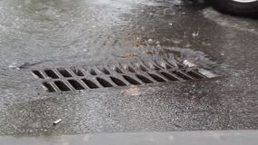 Water drains into the sewer through the iron grid