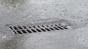 Water drains into the sewer hrough the iron grid