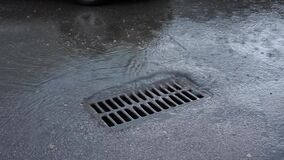 Water drains into the sewer during rain