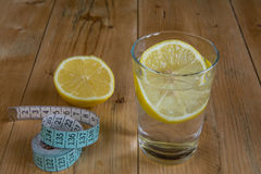Water drink with lemon and measuring tape Royalty Free Stock Photo