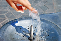 Water drinking fountain. With human hand close up Royalty Free Stock Photography