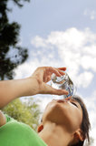 Water drinking in glass. Young woman drinking with water glass Royalty Free Stock Photography