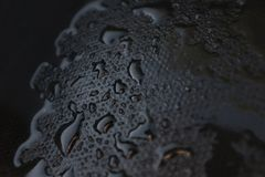 Water drips on a black rubber. Closeup royalty free stock photo