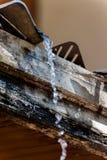 Water drips from the roof. Water drips from the roof Stock Photo