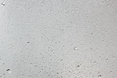 Water drips on silver surface.Abstract background. Water drips on silver surface as abstract background stock photo