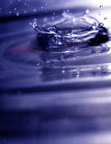 Water Drop 1. A water drop breaking on the water surface Royalty Free Stock Images