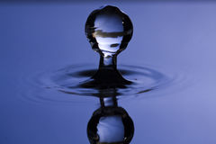 Water Drop. A water drop appearing to be standing still like a sculpture of ice Stock Photo
