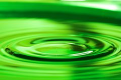Water drop. Green water drop Royalty Free Stock Photography