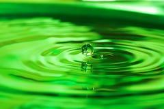 Water drop. Green water drop Royalty Free Stock Photo