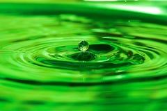 Water drop. Single green water drop Royalty Free Stock Image