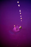 Water drop abstraction like pearls dropping into an ashtray Royalty Free Stock Photos