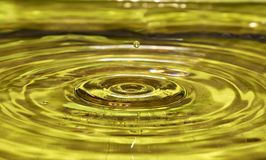 Water drop on air. Water concept on gold surface Royalty Free Stock Photo